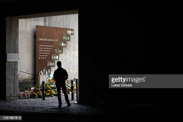 People arrive to commemorate the 10th anniversary of the Love Parade disaster at the disaster site on July 24, 2020 in Duisburg, Germany. 21 people...