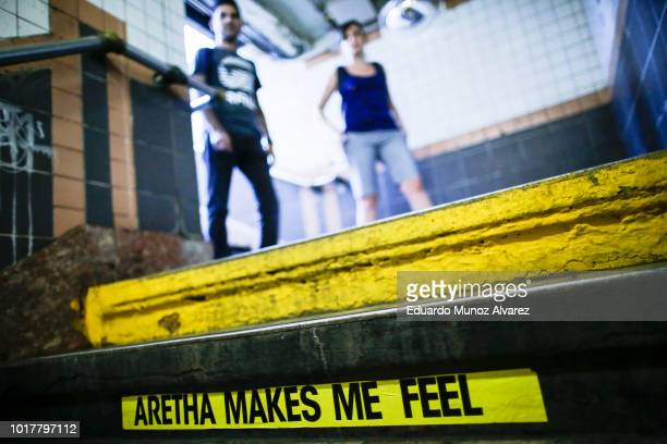 People arrive to Franklin Street Subway station while a message for Aretha Franklin is seen on the subway stairs on August 16 2018 in New York New...
