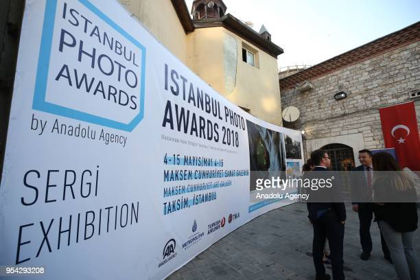 People arrive to inspect the awardwinning photograph of Anadolu Agencys Istanbul Photo Awards 2018 during the exhibition at the Maksem Cumhuriyet Art...