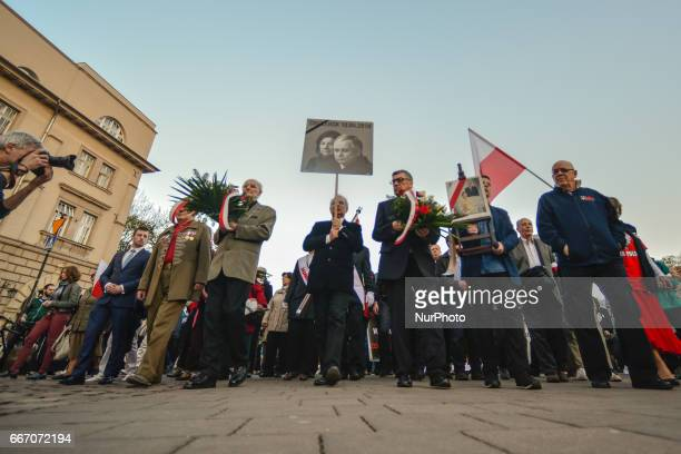 People arrive to Katyn Cross in Krakow after the Holy Mass for President Lech and Maria Kaczynski and all victims of the Smolensk crash disaster In...