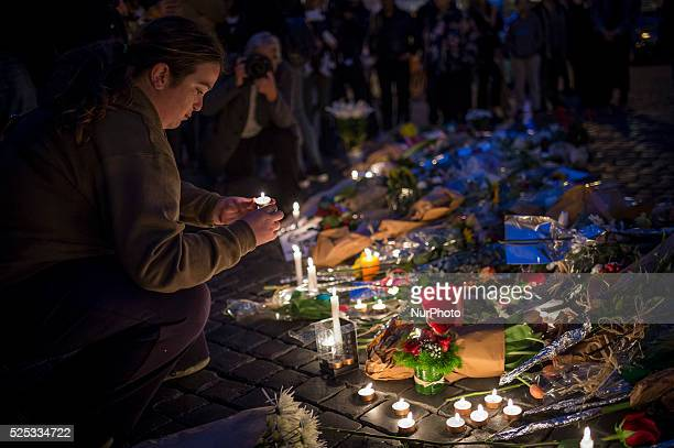 People arrive to lay candles and flowers outside the French embassy in Rome, Italy on 14 November 2015. After at least 130 people were killed in a...