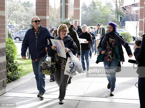 People arrive to participate in Washington State Democratic Caucuses at Martin Luther King Elementary School in Seattle on March 26 2016 / AFP /...