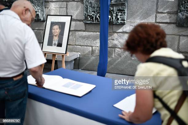 People arrive to pay their respects to women's rights icon French politician and Holocaust survivor Simone and her husband Antoine Veil at the French...