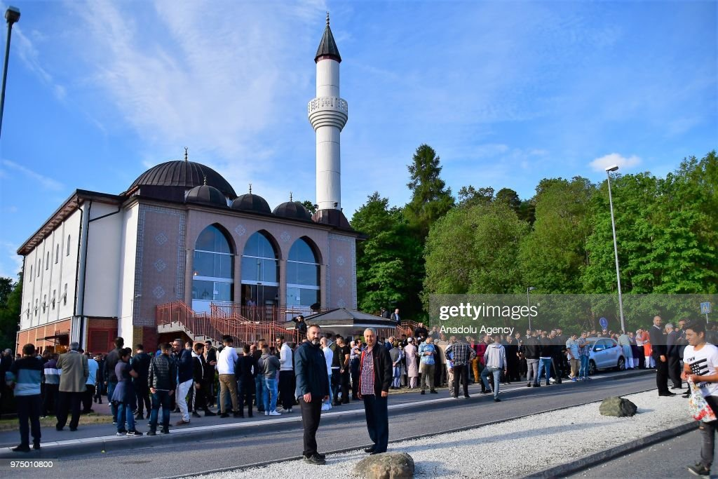 People arrive to perform Eid al-Fitr prayer in Stockholm, Sweden on June 15, 2018. Eid al-Fitr is a religious holiday celebrated by Muslims around the world that marks the end of Ramadan, Islamic holy month of fasting.