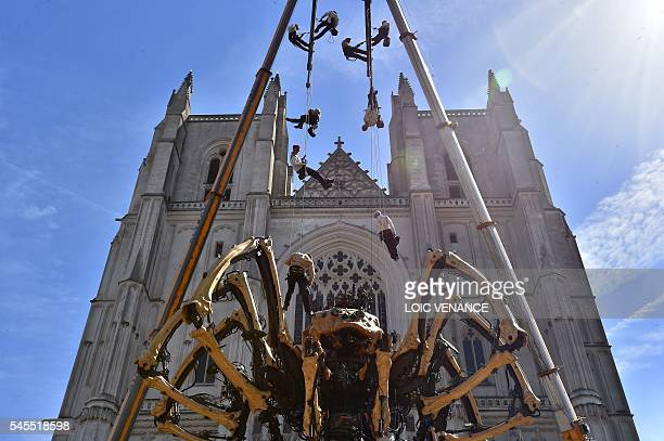 People arrive to pilot Kumo a mechanical spider made of wood and steel by Les Machines de L'Ile factory presented to the public for the first time in...