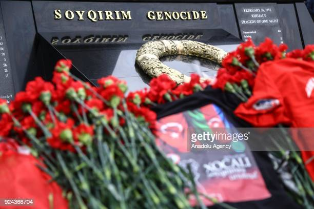People arrive to place carnations at Ana feryadi monument during the 26th anniversary of 'Khojaly Massacre' which happened in February 1992 when...