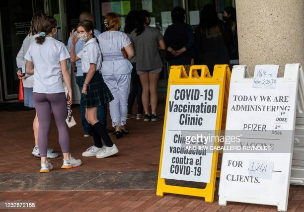People arrive to receive Covid-19 vaccinations at the Fairfax Government Center vaccination clinic in Fairfax, Virginia on May 13, 2021. - The...
