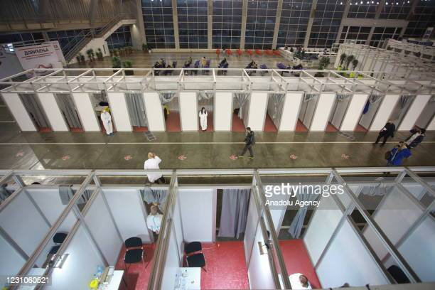 People arrive to receive second dose of Chinas Sinopharms Covid-19 vaccination within mass vaccination campaign in Belgrade, Serbia on February 09,...