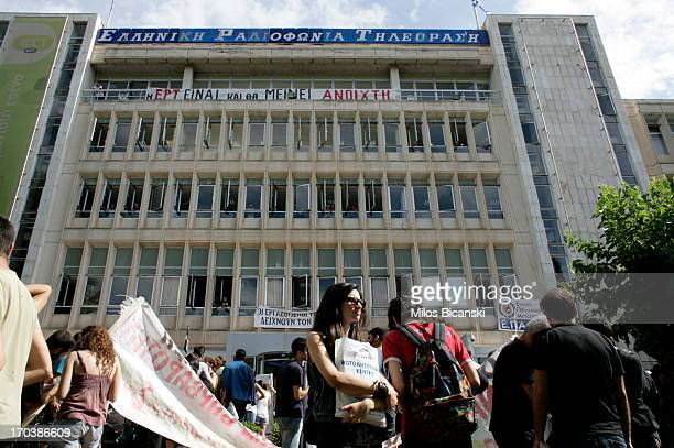 People arrive to support staff occupying the headquarters of the Greek public broadcaster ERT following the announcement of corporations closure on...