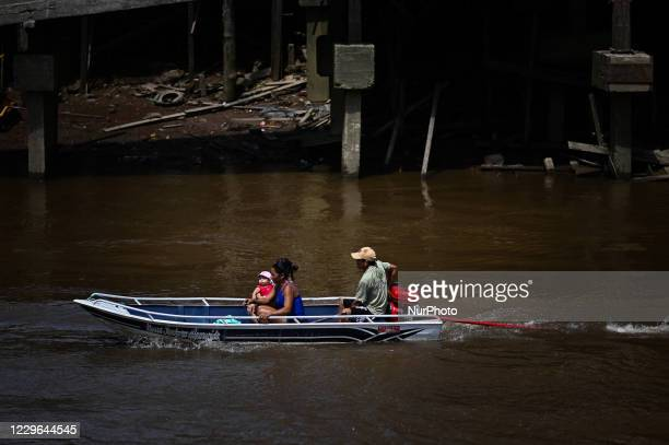 People arrive to vote in a boat during municipal elections amid the Coronavirus pandemic in Santana, Amapá State, Brazil, on November 15, 2020. The...