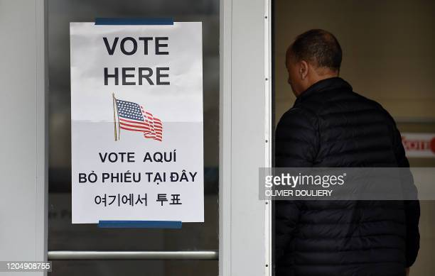 People arrive to vote in the Super Tuesday primary at Belvedere Elementary School on March 3 2020 in Falls Church Virginia Fourteen states and...