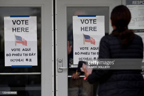 People arrive to vote in the Super Tuesday primary at Frizzell Parrish Hall on March 3 2020 in Annandale Virginia Fourteen states and American Samoa...
