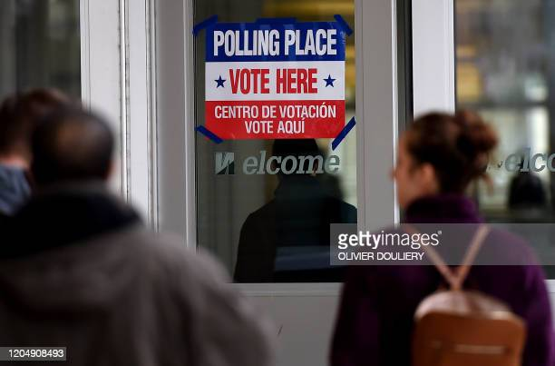 People arrive to vote in the Super Tuesday primary at Wakefield High School March 3 2020 in Arlington Virginia Fourteen states and American Samoa are...