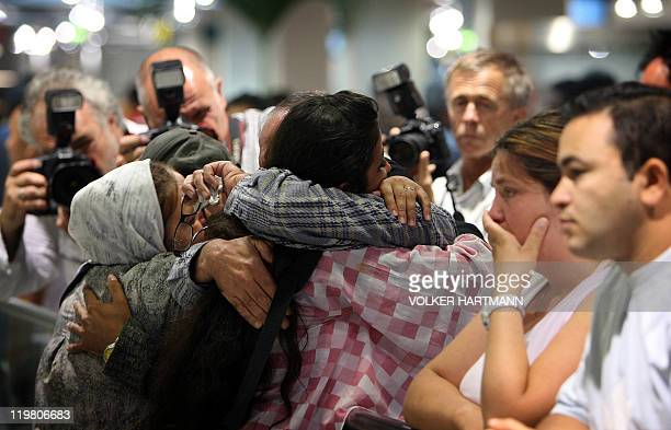 People arriving 18 July 2006 from Damascus are welcomed by their relatives at the airport of Duesseldorf The Airbus that landed in the western German...