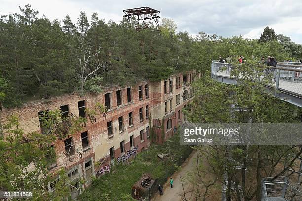 People as seen from the 'Baum und Zeit' elevated platform walk along the ruins of the Beelitzer Heilstaetten sanatorium on May 16 2016 in Beelitz...
