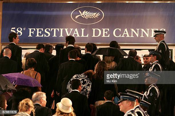 People ascend the steps of the red carpet for the screening of 'L'Enfant' at the Grand Theatre during the 58th International Cannes Film Festival May...