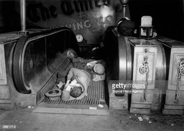 People asleep on the escalators of an underground station in London during an air raid.