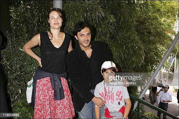 People At 2005 Roland Garros Tennis Tournament On May 25Th 2005 In Paris France Olivier Sitruk With His Wife Alexandra And Son Roman