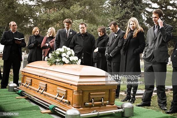 people at a funeral in a cemetery - coffin stock pictures, royalty-free photos & images