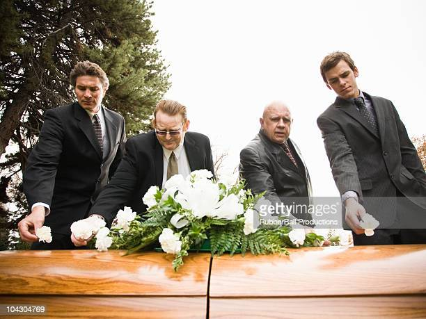 people at a funeral in a cemetery - pallbearer stock photos and pictures