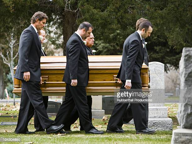 people at a funeral in a cemetery - sarg stock-fotos und bilder