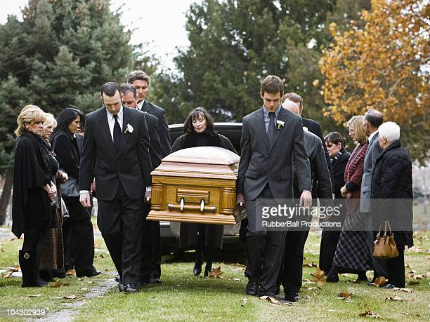 people at a funeral - hearse stock photos and pictures