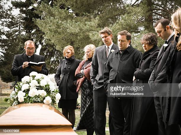 people at a funeral - funeral stock pictures, royalty-free photos & images
