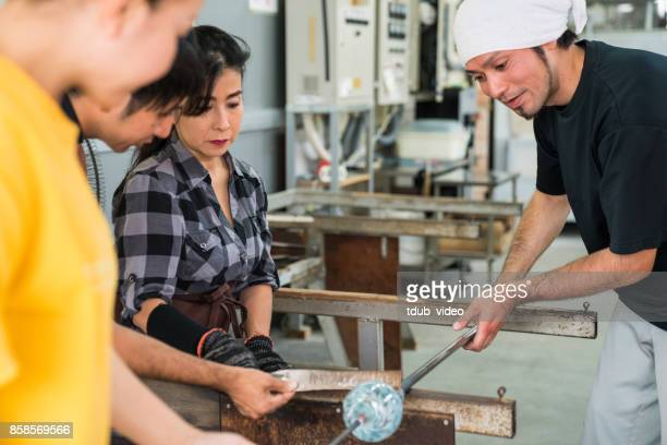 people at a glass factory - tdub_video stock pictures, royalty-free photos & images