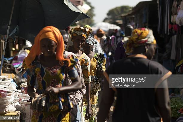 People at a market in Banjul, Gambia on January 22 after the former President Yahya Jammeh left the country. Yahya Jammeh left Gambia after agreeing...