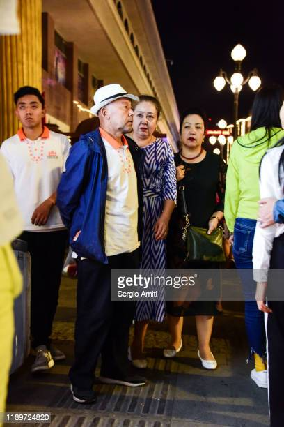 people at a night market in urumqi - sergio amiti stock pictures, royalty-free photos & images