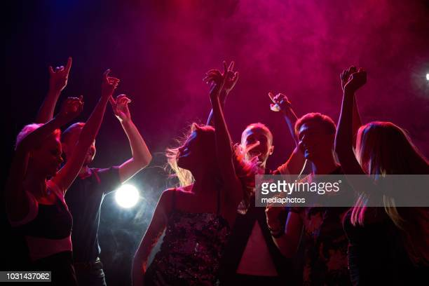 people at a party - party stock pictures, royalty-free photos & images
