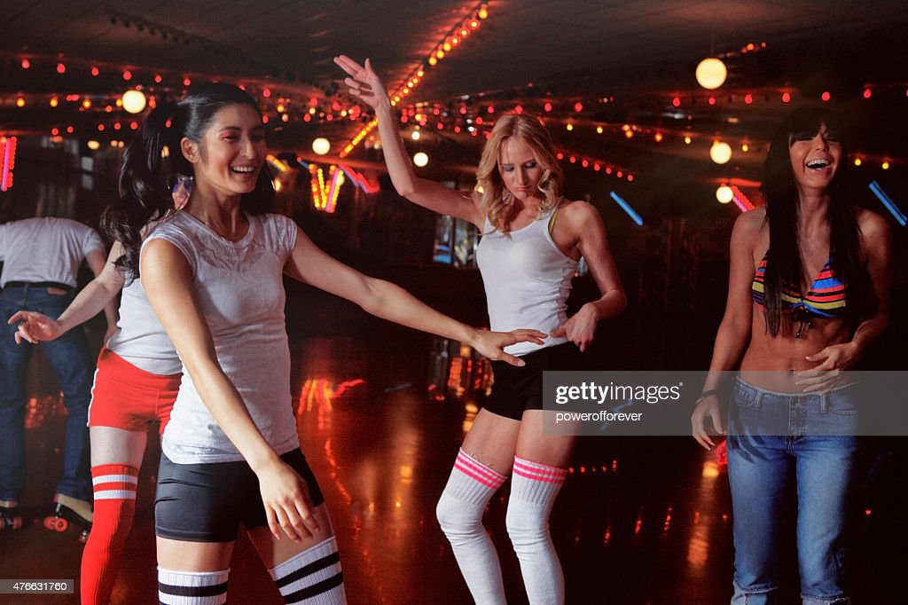 People At A Retro 70s Roller Disco Stock Photo