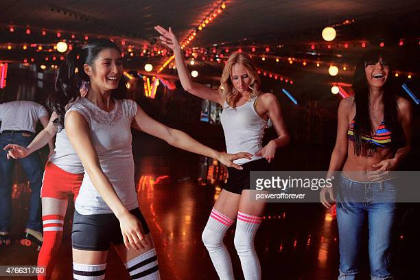people at a retro 70's roller disco - roller skating stock photos and pictures