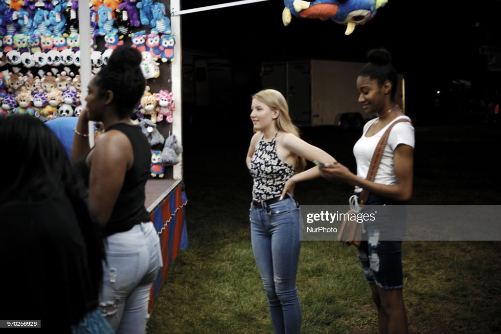 People at a small community carnaval, in Wyndmoor, PA, just outside Philadelphia, on June 8, 2018.