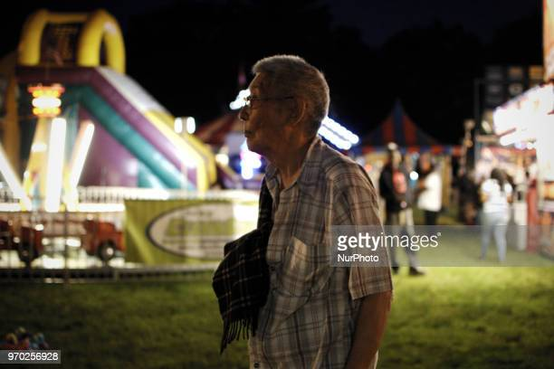 People at a small community carnaval in Wyndmoor PA just outside Philadelphia on June 8 2018