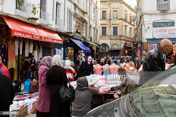 People at a street market in Algiers