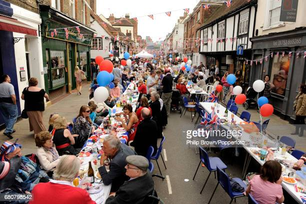 People at a street party in Eton High Street near Windsor Castle on the day that Kate Middleton married Britains Prince William in Westminster Abbey...