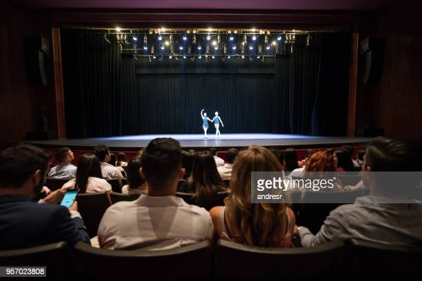 people at a theater looking at a dress rehearsal of ballet performing arts - performance stock pictures, royalty-free photos & images