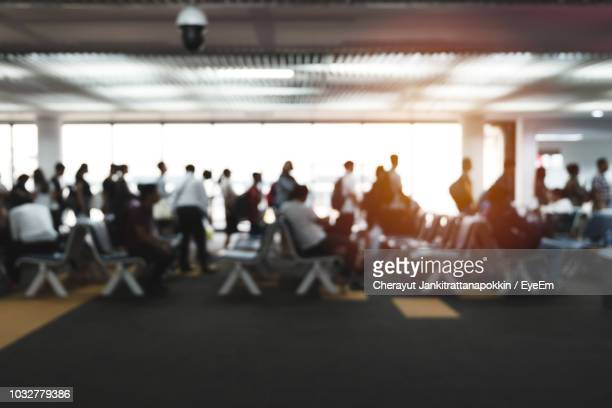 people at airport departure area - gate stock pictures, royalty-free photos & images