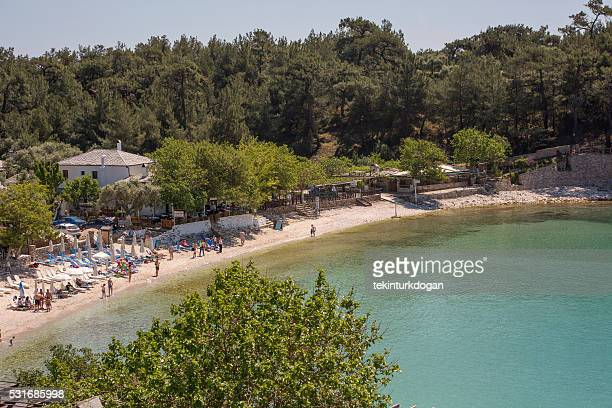 people at aliki beach in thassos island of kavala greece - thasos stock photos and pictures