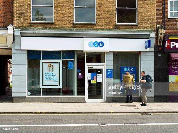 People at an ATM outside a TSB Bank branch