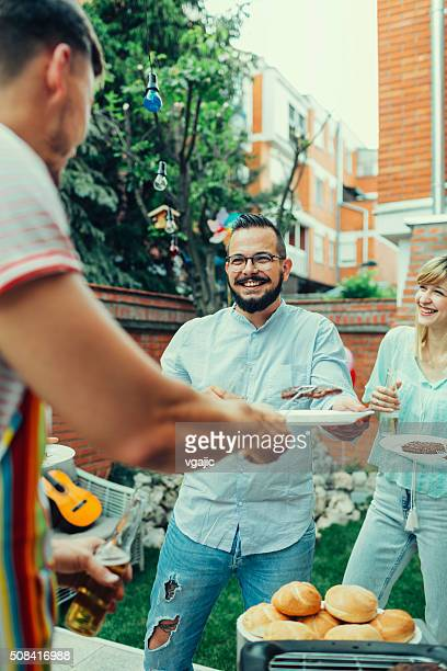 People At Barbecue Party