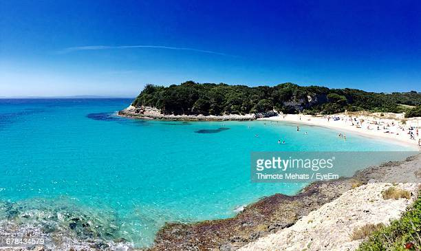 people at beach against blue sky - corsica stock-fotos und bilder