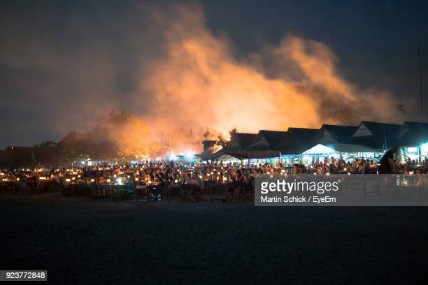 People At Beach Against Sky At Night