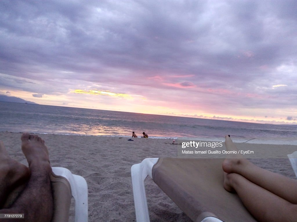 People At Beach Against Sky During Sunset : Photo