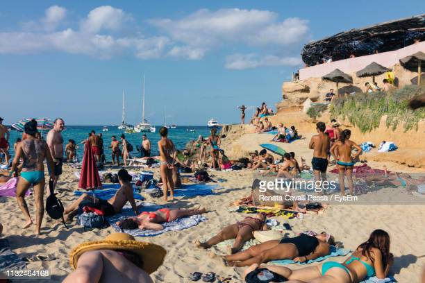 people at beach against sky - balearic islands stock pictures, royalty-free photos & images