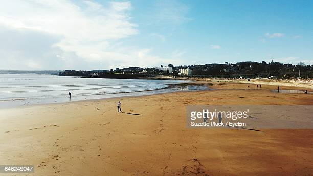 people at beach against sky - torquay,_victoria stock pictures, royalty-free photos & images