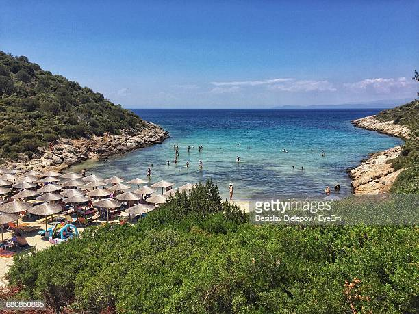 people at beach in thasos against sky - thasos stock photos and pictures