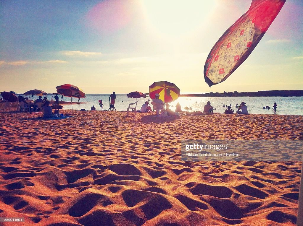People At Beach On Sunny Day : Stock Photo