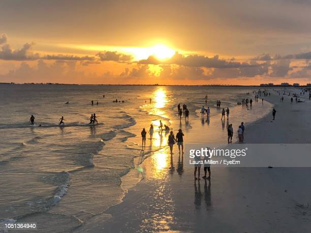 people at beach - fort myers beach stock pictures, royalty-free photos & images